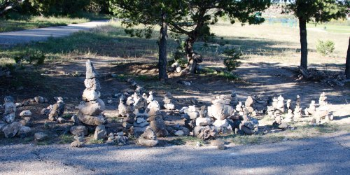 "A little ""stone forest"" sprouted on a school yard, a spontaneous creation.  Every so often, it gets flattened, and a few days later, a new one pops up."